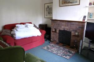 Gate Cottage on the Pekes Manor Estate. The Sitting Room, showing Sofa Bed with fresh linen.