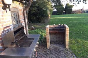 The Manor House at Pekes – the barbecue overlooking Ducks Lawn.