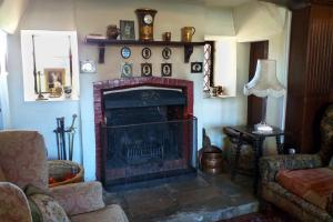 The Manor House at Pekes. The fireplace in the Living Room.
