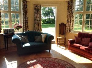 The Oast House on the Pekes Manor Estate. The Living Room with direct access to the gardens.