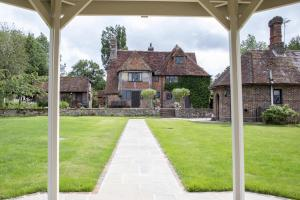 The Pekes Manor Estate. The Manor House and Tudor View from the Gazebo on the Ceremony Lawn.