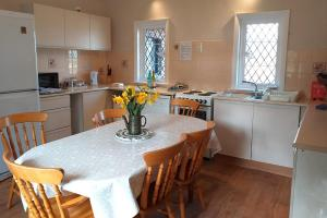 Tudor View on the Pekes Manor Estate. The Kitchen with Dining Area.