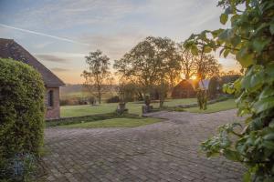 Tudor View on the Pekes Manor Estate. The sun begins to set.